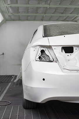 Auto Body Repair : Closeup Of White Car In Paint Booth